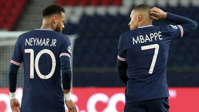 Neymar Jr and Kylian Mbappe of Paris Saint-Germain walk with Presnel Kimpembe during the UEFA Champions League Group H stage match between Paris Saint-Germain and Manchester United at Parc des Princes on October 20, 2020 in Paris, France.
