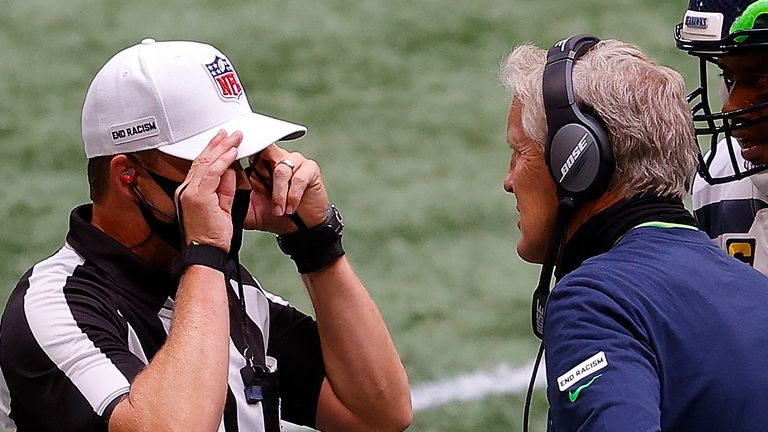 Seattle Seahawks head coach Pete Carroll converses with referee Shawn Hochuli during a game last month
