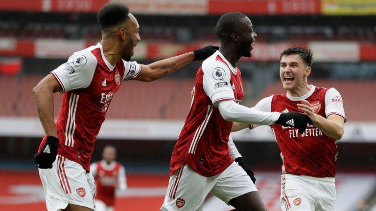 Nicolas Pepe celebrates making it 2-0 against Sheffield United