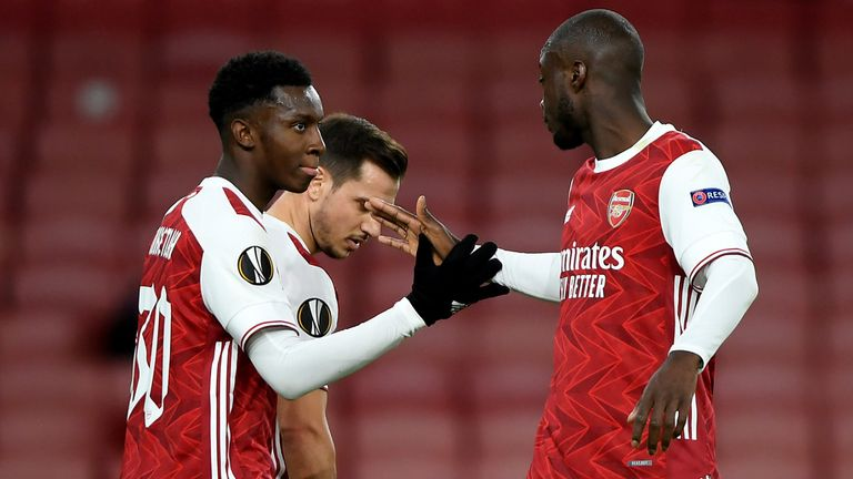 LONDON, ENGLAND - OCTOBER 29: Eddie Nketiah of Arsenal celebrates with teammate Cedric Soares and Nicolas Pepe of Arsenal after scoring his team's first goal during the UEFA Europa League Group B stage match between Arsenal FC and Dundalk FC at Emirates Stadium on October 29, 2020 in London, England.