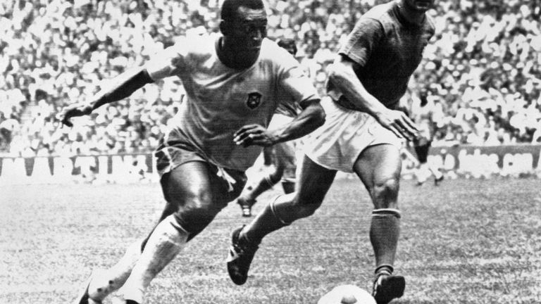 Brazilian midfielder Pelé (L) dribbles past Italian defender Tarcisio Burgnich during the World Cup final on 21 June 1970 in Mexico City. Pelé scored the opening goal for his team as Brazil went on to beat Italy 4-1 to capture its third World title after 1958 (in Sweden) and 1962 (in Chile)