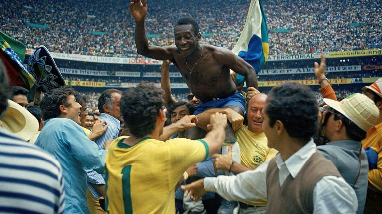 Pele is carried aloft after Brazil win the 1970 World Cup final against Italy in Mexico