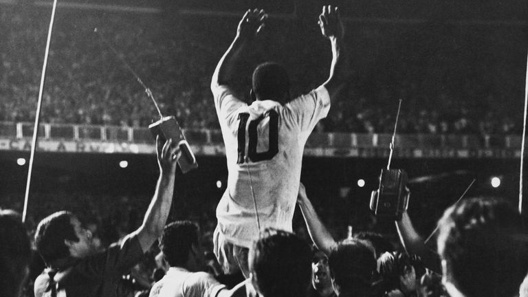 Pele is lifted up by his Santos team mates after scoring the 1,000th goal of his career during a game against Vasco da Gama at the Maracana Stadium, Rio de Janeiro, Brazil, 19th November 1969.