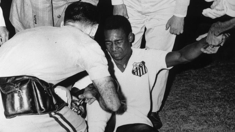 4th July 1961: Brazilian footballer Pele receiving treatment during a game between Santos and Panathinaikos in Athens.