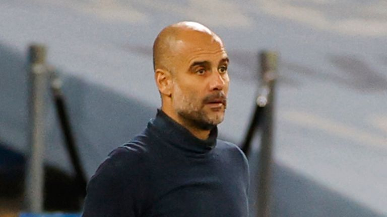 Pep Guardiola watches on during Manchester City's win against Porto in the Champions League