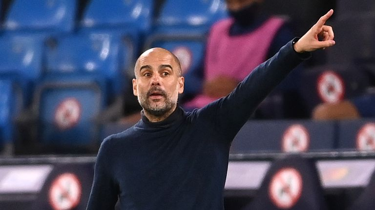 Pep Guardiola gives instructions during Manchester City's 3-1 win against Porto in the Champions League