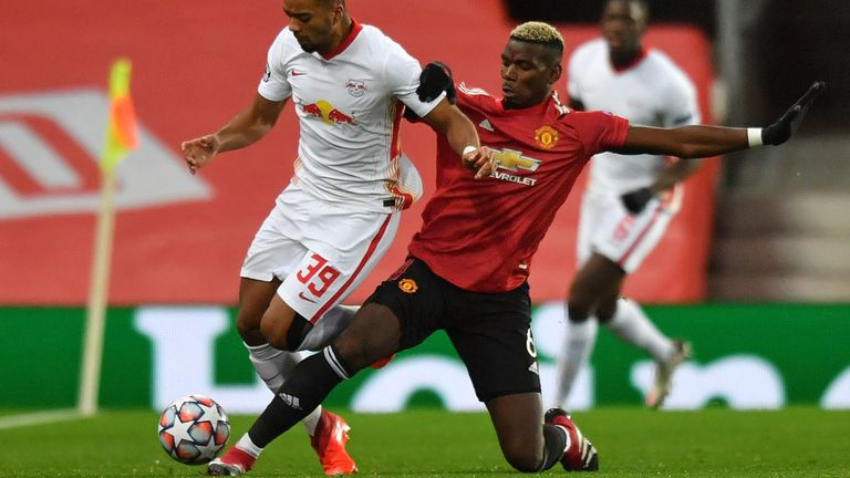 RB Leipzig's German defender Benjamin Henrichs (L) vies with Manchester United's French midfielder Paul Pogba during the UEFA Champions league group H football match between Manchester United and RB Leipzig at Old Trafford