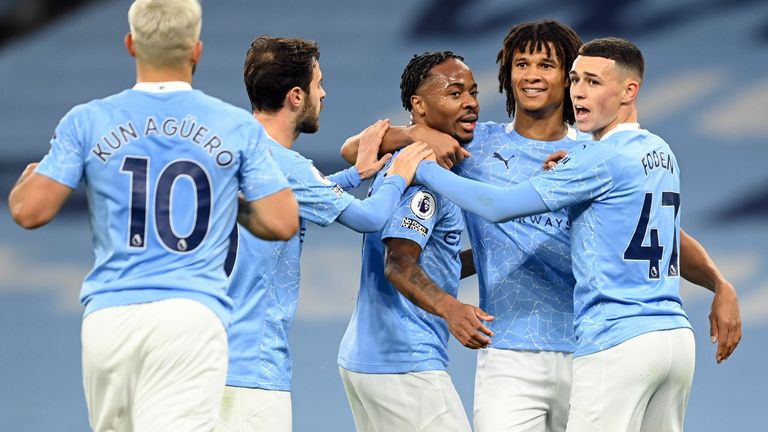 Raheem Sterling celebrates scoring the opening goal of the game with team-mates