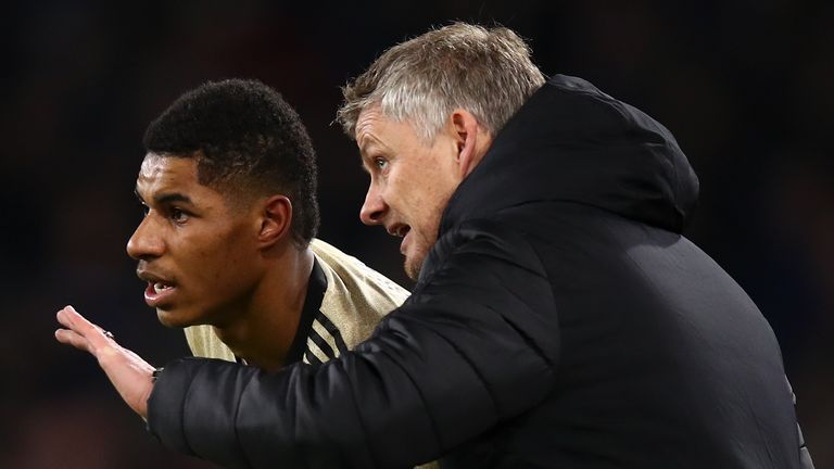 Marcus Rashford of Manchester United and Ole Gunnar Solskjaer the head coach / manager of Manchester United during the Premier League match between Burnley FC and Manchester United at Turf Moor on December 28, 2019 in Burnley, United Kingdom