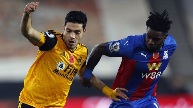 Wolves' Raul Jimenez and Crystal Palace's Jeffrey Schlupp battle for the ball