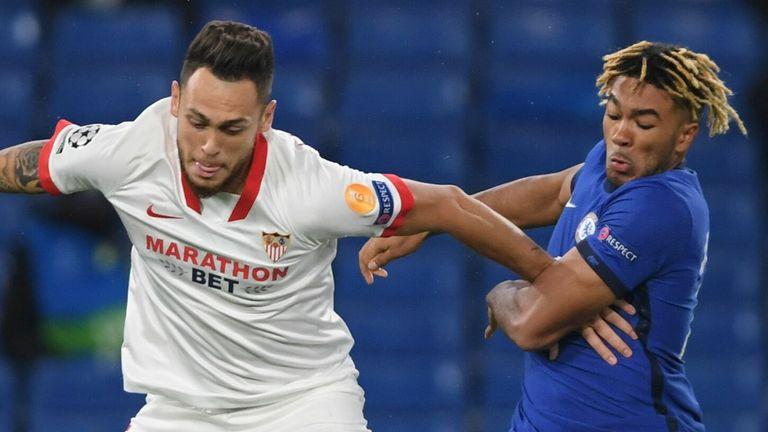 Sevilla midfielder Lucas Ocampos (L) vies with Chelsea's Reece James