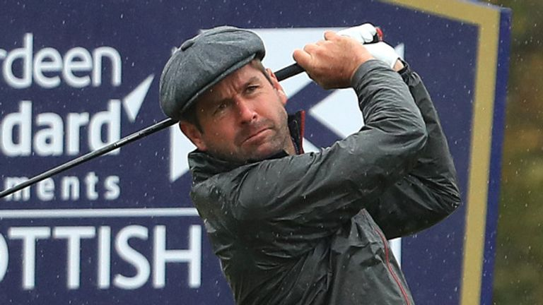 Robert Rock retained the lead on nine under