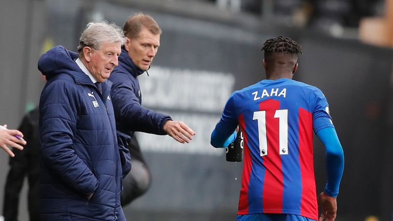 Roy Hodgson speaks to Zaha on the touchline during the encounter