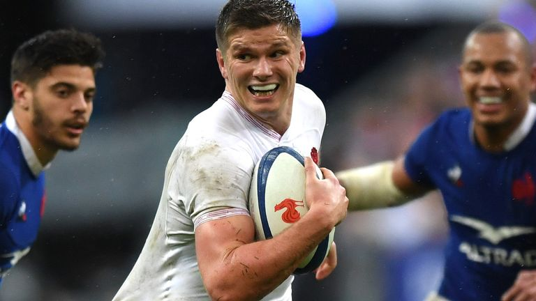 Owen Farrell of England is tackled Boris Palu of France