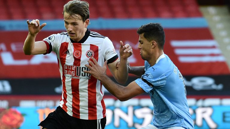 SHEFFIELD, ENGLAND - OCTOBER 31: Sander Berge of Sheffield United is challenged by Rodri of Manchester City during the Premier League match between Sheffield United and Manchester City at Bramall Lane on October 31, 2020 in Sheffield, England.