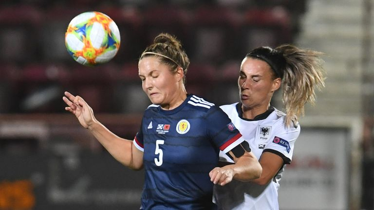 Hannah Godrey (L) in action with Albania's Zylfije Bajramaj during a UEFA Women's EURO 2021 qualifier between Scotland and Albania at Tynecastle