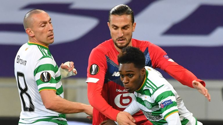 Lille Yusuf Yazici (C) vies for the ball with Celtic duo Scott Brown and Jeremie Frimpong