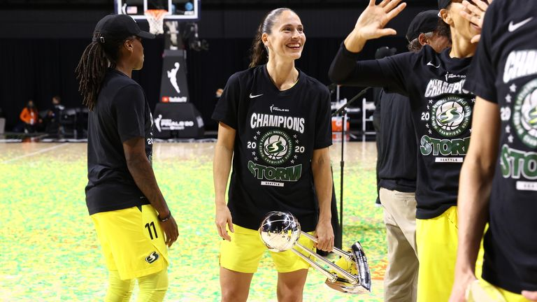Sue Bird of the Seattle Storm holds on to the WNBA Championship trophy after defeating the Las Vegas Aces in the WNBA Finals