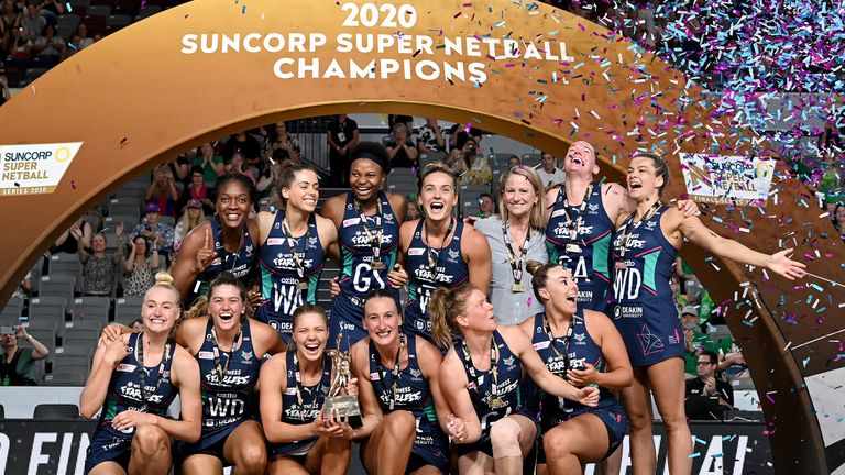 The Vixens celebrating with the trophy after their Grand Final triumph