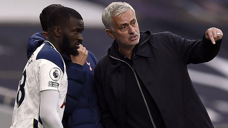 Tanguy NDombele with Tottenham boss Jose Mourinho