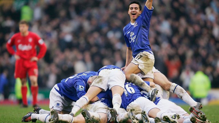 Tim Cahill celebrates as the Everton team pile on top of scorer Lee Carsley