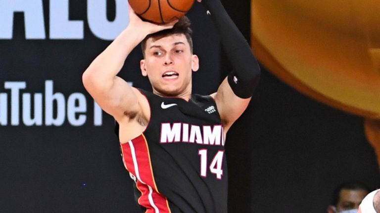 Miami Heat rookie Tyler Herro throws a mid-air pass during Game 4 of the NBA Finals