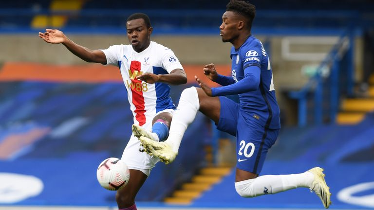 Tyrick Mitchell and Callum Hudson-Odoi in Premier League action at Stamford Bridge
