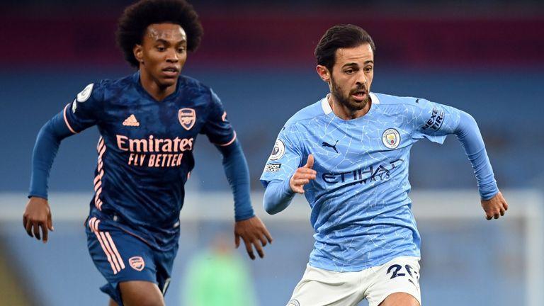 Arsenal's Willian chases Manchester City's Bernardo Silva