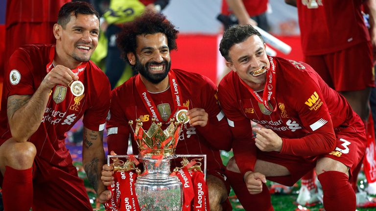Dejan Lovren, Mohamed Salah and Xherdan Shaqiri of Liverpool celebrate with The Premier League trophy following the Premier League match between Liverpool FC and Chelsea FC at Anfield on July 22, 2020 in Liverpool, England. Football Stadiums around Europe remain empty due to the Coronavirus Pandemic as Government social distancing laws prohibit fans inside venues resulting in all fixtures being played behind closed doors