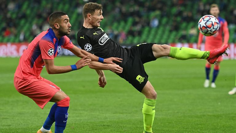 Chelsea's Moroccan midfielder Hakim Ziyech and FK Krasnodar's Russian defender Evgeni Chernov vie for the ball during the UEFA Champions League football match between Krasnodar and Chelsea at the Krasnodar stadium in Krasnodar on October 28, 2020. (Photo by Kirill KUDRYAVTSEV / AFP) (Photo by KIRILL KUDRYAVTSEV/AFP via Getty Images)