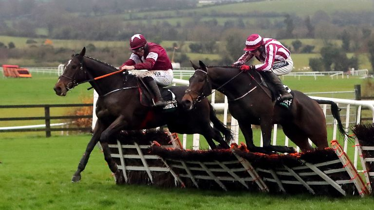 Abacadabras ridden by Jockey Jack Kennedy (left) clears the last in the Morgiana Hurdle