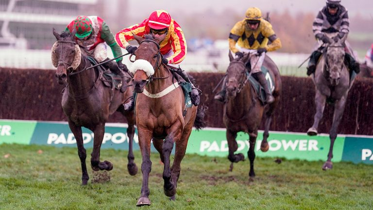 CHELTENHAM, ENGLAND - NOVEMBER 14: Tom O'Brien riding Coole Cody (red/yellow) clear the last to win The Paddy Power Gold Cup Handicap Chase at Cheltenham Racecourse on November 14, 2020 in Cheltenham, England. Owners are allowed to attend if they have a runner at the meeting otherwise racing remains behind closed doors to the public due to the Coronavirus pandemic. (Photo by Alan Crowhurst/Getty Images)