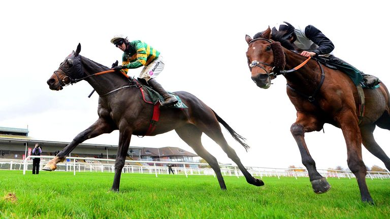 Mark Walsh and Sire Du Berlais (left) on their way to winning the Lismullen Hurdle at Navan