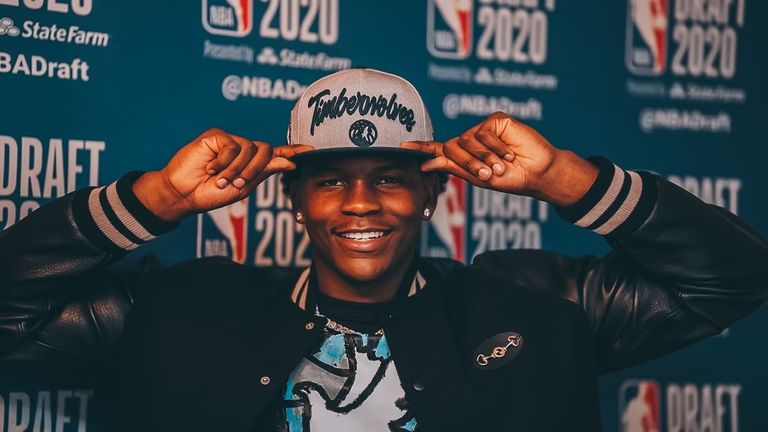 Edwards poses in his Timberwolves hat