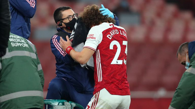 Arsenal's Brazilian defender David Luiz receives treatment after clashing heads with Wolverhampton Wanderers' Mexican striker Raul Jimenez during the English Premier League football match between Arsenal and Wolverhampton Wanderers at the Emirates Stadium in London on November 29, 2020