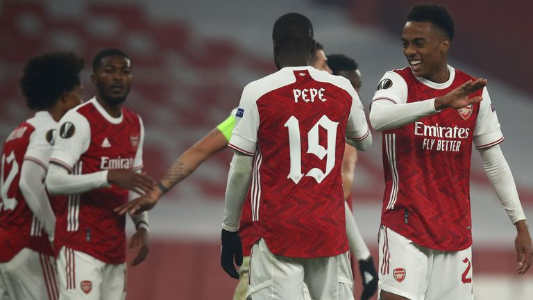 Arsenal players celebrate after taking the lead against Molde