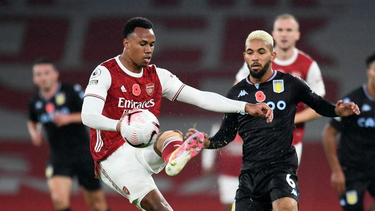 Gabriel Magalhaes comes under pressure from Douglas Luiz