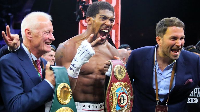 Barry Hearn, left, with Anthony Joshua and his son Eddie Hearn