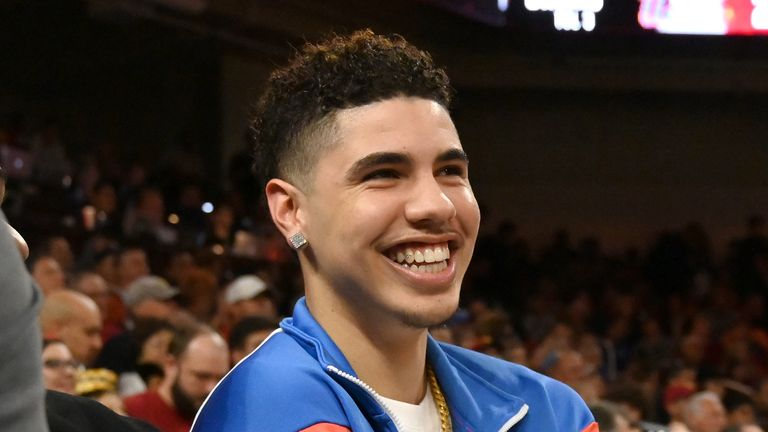 Professional basketball player LaMelo Ball, right, attends the game between the USC Trojans and the UCLA Bruins at Galen Center on March 7, 2020 in Los Angeles, California