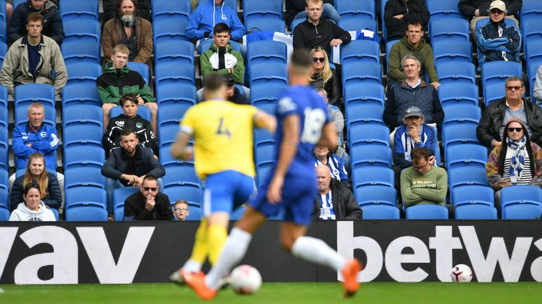 Distanced fans watch Brighton play Chelsea in a test friendly