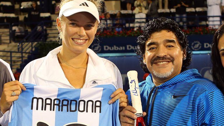 Caroline Wozniacki (left) exchanges gifts with football legend Maradona in Dubai