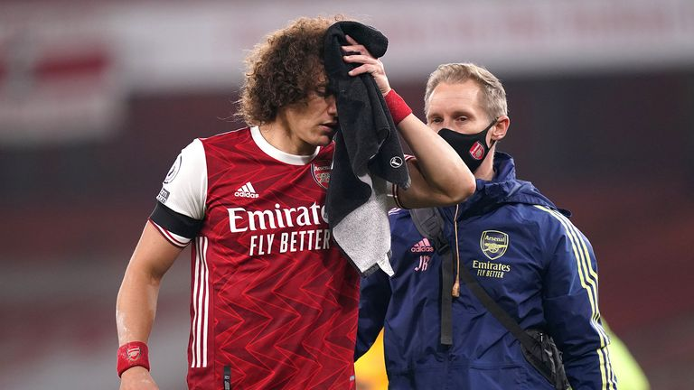David Luiz of Arsenal receives medical treatment after a collision with Raul Jimenez of Wolverhampton Wanderers (not pictured) during the Premier League match between Arsenal and Wolverhampton Wanderers at Emirates Stadium on November 29, 2020 in London, England.