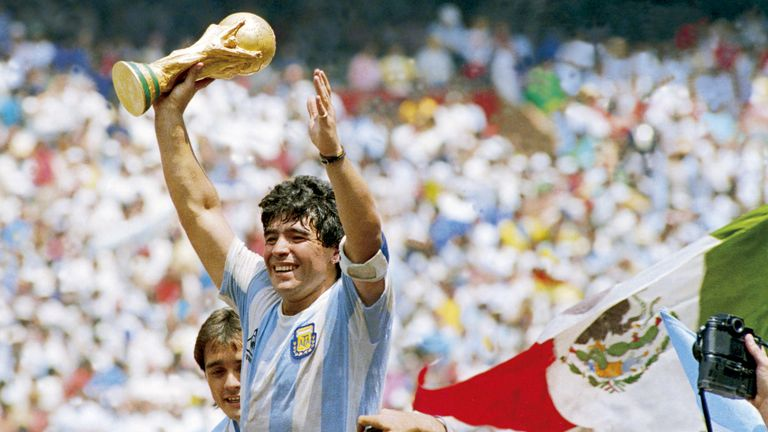 Diego Maradona of Argentina holds the World Cup trophy after defeating West Germany 3-2 during the 1986 FIFA World Cup Final match at the Azteca Stadium on June 29, 1986 in Mexico City, Mexico