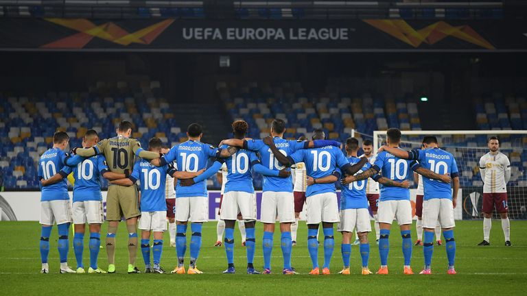 The Napoli players gather for a minute's silence before kick-off