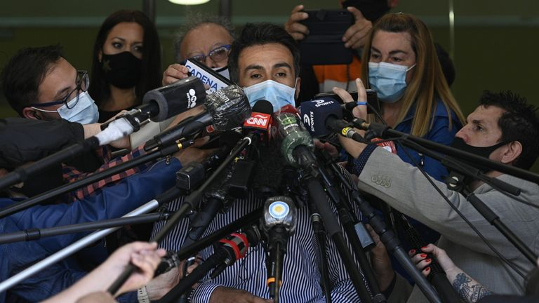 Leopoldo Luque, the personal physician of Argentine former football star and coach of Gimnasia y Esgrima La Plata Diego Maradona, gives a medical report outside the private clinic where he underwent a brain surgery for a blood clot