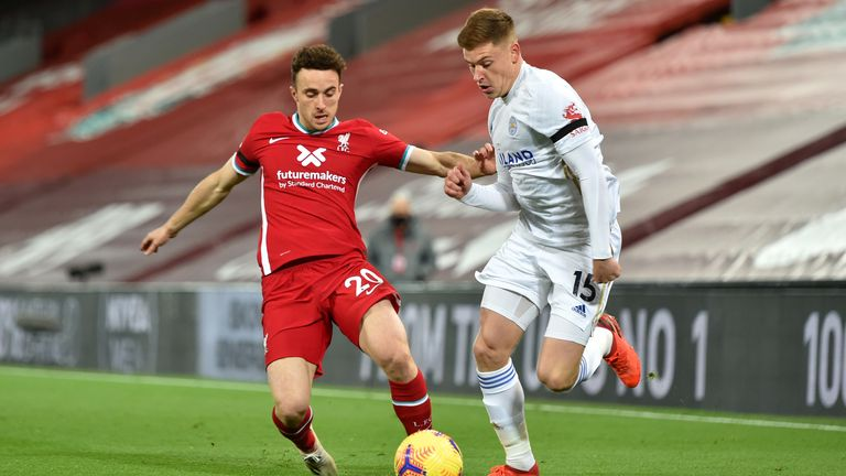 Diogo Jota battles for possession with Harvey Barnes at Anfield