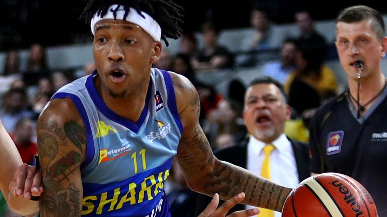 Dirk Williams of Sheffield Sharks drives to the basket against the London Lions' Brandon Peel at Copper Box Arena on March 22, 2019