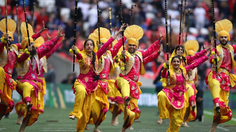 A Diwali Bangra Dance Group perform at half time during the Premier League match between Tottenham Hotspur and AFC Bournemouth at Wembley Stadium on October 14, 2017 in London, England