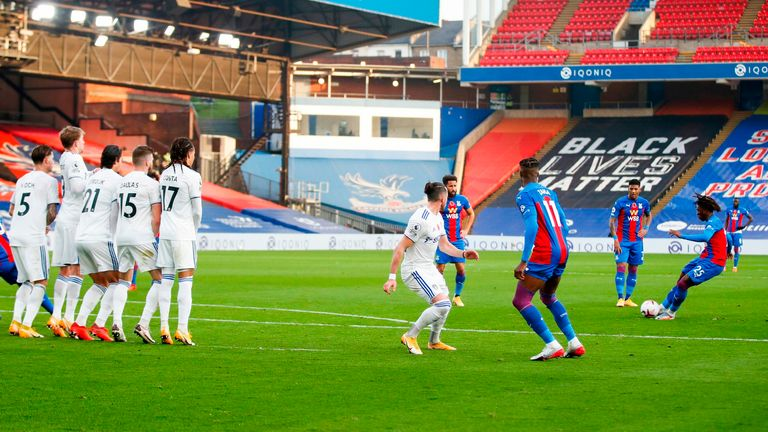 Ebere Eze curls his free-kick in via the underside of the crossbar