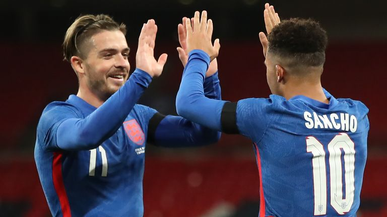 Jack Grealish and Jadon Sancho celebrate England's second goal